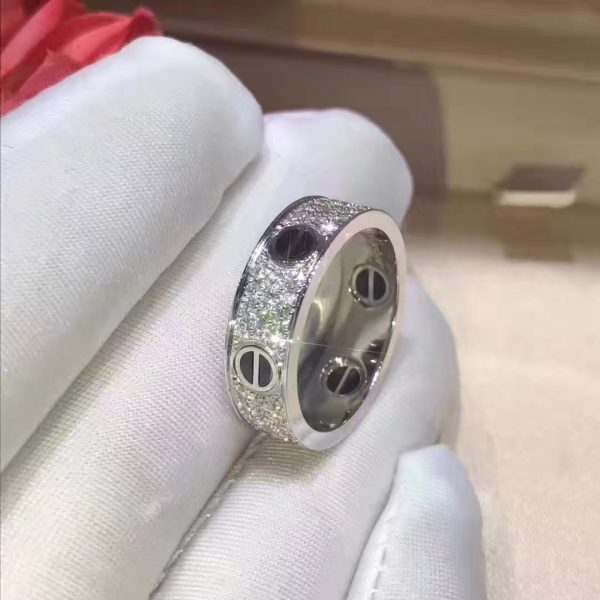 Cartier Love ring, 18K white gold, black ceramic, set with 66 brilliant-cut diamonds totaling 0.74 carats. Width: 6.5mm. Material: Pure 18K Yellow/Pink/White Gold Colors: Yellow Gold, Pink Gold, White Gold